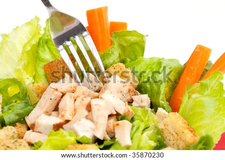 Chicken Caesar Salad detail with carrots and croutons