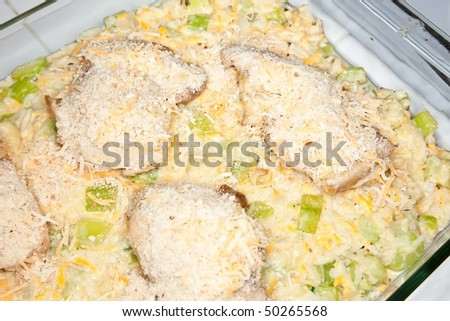Chicken casserole with chicken, rice, zucchini, and other vegetables and cheese