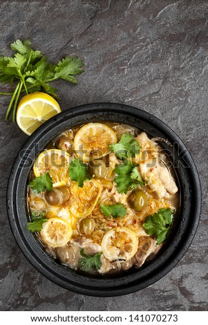 Chicken casserole with lemon, olives and cilantro.  Cooked in traditional tagine.
