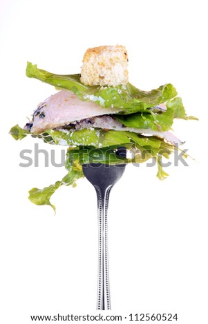 Chicken ceasar salad isolated on white background