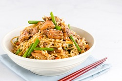 Chicken Chow Mein with Chopsticks on White Background. Chinese Food Photography.
