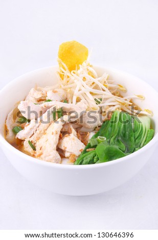Chicken clear noodle soup with won ton.