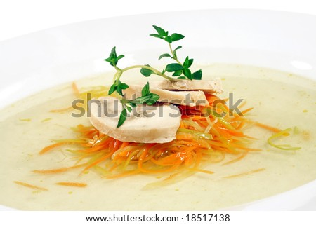 Chicken Consomme with Julienne Vegetable Served with Green. Isolated on White Background