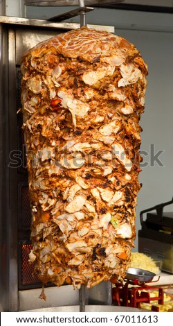 The Culture Cup Round x - Adam is a naughty naughty boy - Page 4 Stock-photo-chicken-cooking-on-rotating-vertical-spit-for-turkish-doner-kebab-67011613