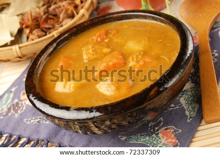Chicken curry in black bowl