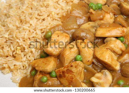 Chicken curry served with egg fried rice.