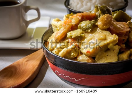 chicken curry with boiled basmaty rice on bowl