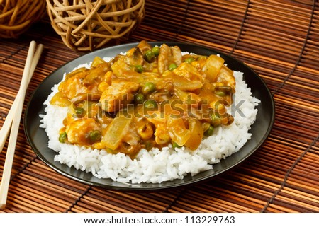Chicken Curry with boiled rice a popular chinese food available at take aways