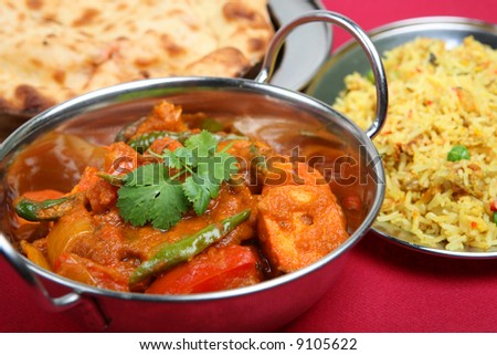 Chicken curry with rice and naan - stock photo
