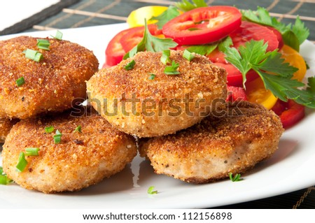 chicken cutlets with vegetables and herbs
