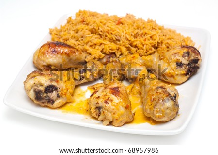 chicken drumbsticks and mexican rice on white