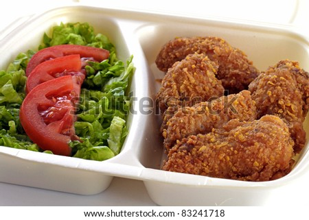 chicken drumstick and vegetable salad