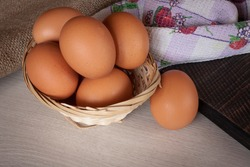 Chicken eggs on a wooden table close up.