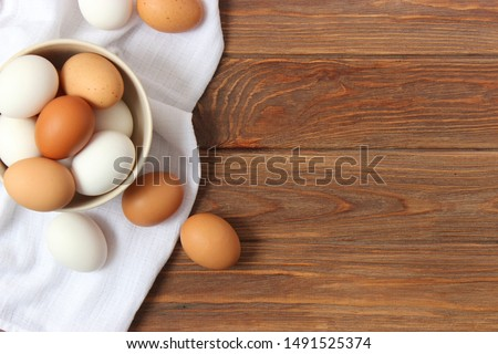 chicken eggs on the table. Farm products, natural eggs.  #1491525374