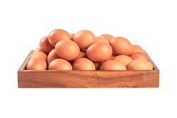 Chicken eggs on wooden tray isolated on white background.