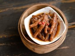 Chicken feet dim sum in bamboo steamer chinese cuisine