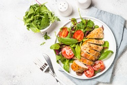 Chicken fillet with salad. Healthy food, keto diet, diet lunch concept. Top view on white background.