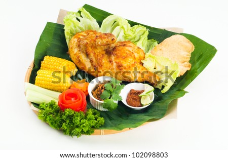 chicken. Grilled chicken with vegetables on the background.