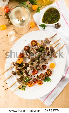 Chicken Hearts Grilled with Heirloom Cherry Tomatoes on Wooden Skewers