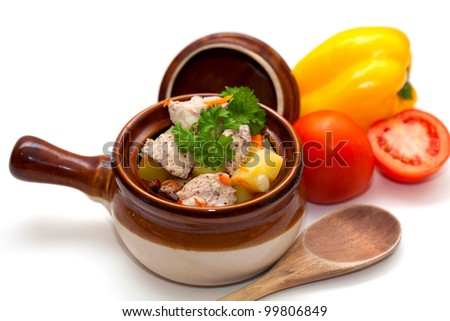 chicken in pot and vegetables isolated on white