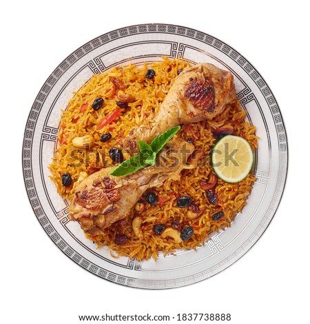 Chicken Kabsa or Chicken biryani isolated on white background. Kabsa is traditional saudi arabian cuisine dish. It cooks with basmati rice, chicken, spices, tomatoes, nuts, raisins. Top view