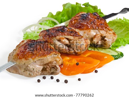 chicken kebab with lots of different vegetables