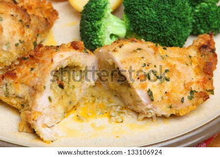 Chicken kiev dinner with broccoli and roast potatoes