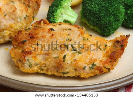 Chicken Kiev served with vegetables.