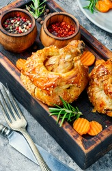 Chicken legs in pastry.Chicken leg in puff pastry on cutting board