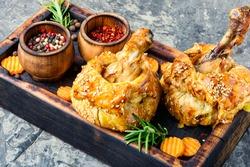 Chicken legs in pastry.Chicken leg in puff pastry on cutting board.Baked chicken drumsticks