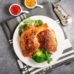 Chicken Legs with Vegetables on gray  background.Top view.