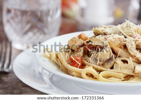 Chicken linguine with grilled chicken, tomatoes, mushrooms and freshly grated parmesan cheese.