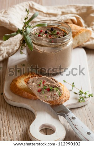 Chicken liver pate on bread and in jar