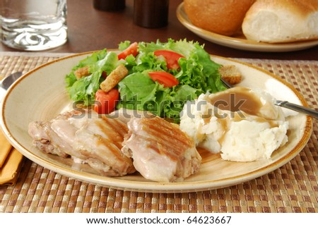 Chicken, mashed potatoes and salad