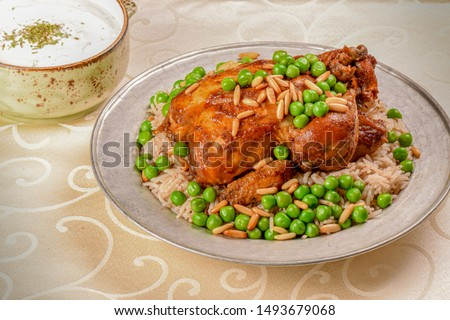 Chicken Mehshi-Chicken and Rice Styled and Garnished on White Plate