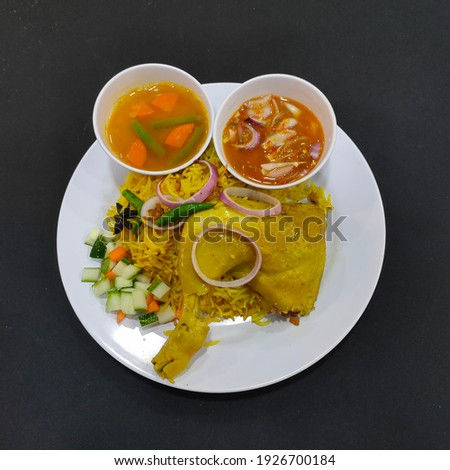 Chicken Mendy rice by malay cook with sauce and  soup on black table Stock photo ©