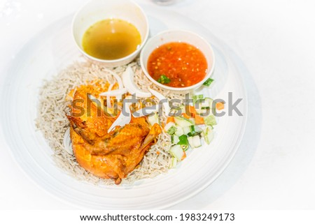 Chicken Mendy Rice with turmeric soup and spicy tomato dip Stock photo ©