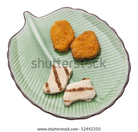 Chicken Nugget Choice of Breaded and Friend Nuggets vs. Baked Organic Nuggest.  Health and Food concept.  Isolated on White with a Clipping Path.
