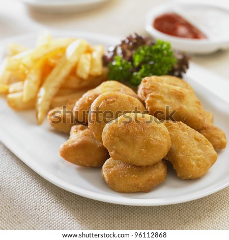 chicken nugget with fry in the plate