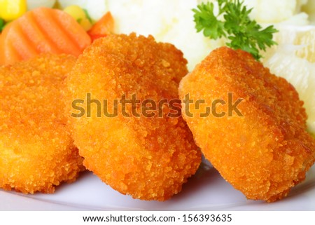 Chicken nuggets with mashed potatoes and vegetables