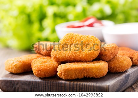 chicken nuggets with sauces on wooden board Сток-фото ©