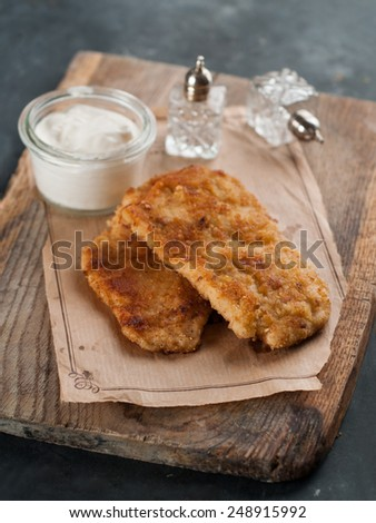 Chicken or pork schnitzel with sauce, selective focus