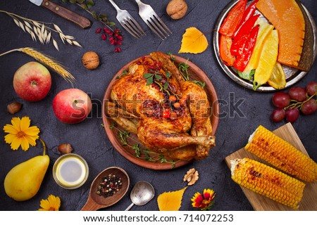 Shutterstock Chicken or turkey, fruits and grilled autumn vegetables: corn, pumpkin, paprika. Thanksgiving food concept. Harvest or Thanksgiving background. View from above, top studio shot, overhead, horizontal