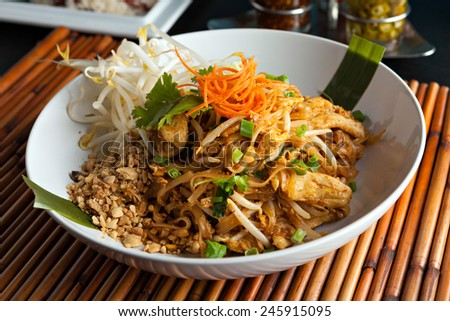 Chicken pad Thai dish of stir fried rice noodles with a contemporary presentation #245915095