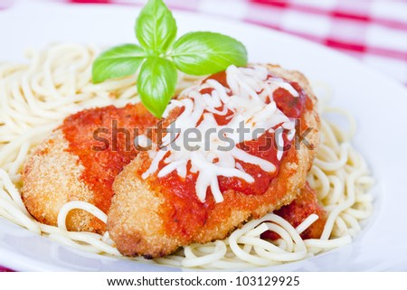 Chicken parmigiana on a white plate with spaghetti - stock photo