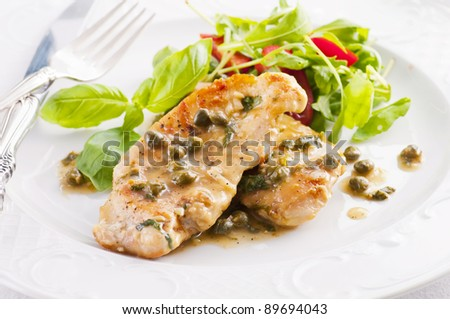chicken piccata with capern and salad