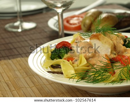 Chicken pieces with tagliatelle pasta and vegetables