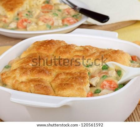 Chicken pot pie in a white casserole dish