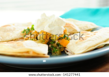chicken quesadilla with salsa and sour cream #141277441