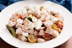 chicken, quinoa, chickpea salad with goat cheese and fresh vegetables